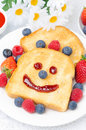 Toast with a smile out of a jam fresh berries for breakfast close up vertical Royalty Free Stock Images