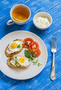 Toast with soft feta cheese and quail eggs - a healthy Breakfast or snack Royalty Free Stock Photo
