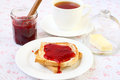 Toast with strawberry jam and cup of tea Stock Image
