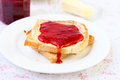 Toast with strawberry jam running Stock Image