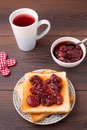 Toast with strawberry jam on a wooden table Royalty Free Stock Photo