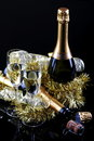 Toast to the beginning of the year glasses sparkling wine with bottles on a black background with decorations Stock Photography