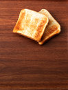 Toast on wooden ground one and another Royalty Free Stock Photos