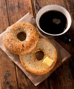 Toasted bagel a delicious everything with melted butter and black coffee Royalty Free Stock Images