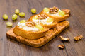 Toasted baguette with italian gorgonzola cheese grapes and walnuts Stock Image
