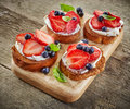 Toasted bread with berries and cream cheese Royalty Free Stock Photo