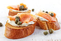 Toasted bread with cream cheese and salmon fillet smoked on wooden table Stock Photography