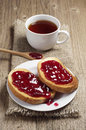 Toasted bread with strawberry jam and tea cup Royalty Free Stock Photo