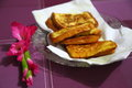 Toasted breads and flower beside snack snacks breakfast quick food ready food Stock Images