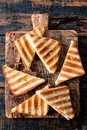 Toasted sandwich panini with ham and cheese Royalty Free Stock Photo