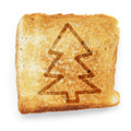 Toasted slice of white bread with christmas tree on background Royalty Free Stock Images