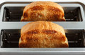 Toaster with bread close up of two pieces of Royalty Free Stock Photography