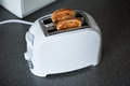 A toaster with slices of bread Royalty Free Stock Photo