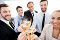 Toasting to success group of business people with champagne and smiling while standing close each Royalty Free Stock Images