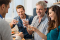 Toasting with wine glasses happy friends at home Royalty Free Stock Photography
