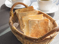 Toasts in basket Breakfast set with coffee Royalty Free Stock Photo