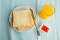 Toasts jam and orange juice breakfast with Stock Image