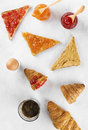 Toasts with jam and peanut paste, croissant, coffee Royalty Free Stock Photo