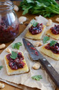 Toasts with plum chutney topped with coriander leaves french piquant Stock Photos