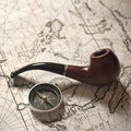 Tobacco pipe & compass Royalty Free Stock Photo