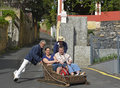 Toboggan at monte madeira portugal tourists being guided downhill in wicker tobaggan or sled near funchal Stock Image