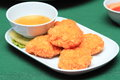 Tod man goong thai style appetizers deep fried breaded shrimp cakes served with sweet plum sauce Stock Photos