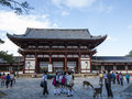 Todai ji temple at nara visitors and deer buddhist in japan Royalty Free Stock Photos