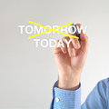 Today businessman crosses off tomorrow for with yellow marker pen on the screen Royalty Free Stock Photography