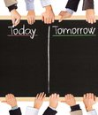 Today tomorrow photo of business hands holding blackboard and writing and Royalty Free Stock Photography