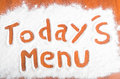 Todays menu sign flour artwor with artwork with food and handprints fun background with human handpints in scattered on a wooden Royalty Free Stock Photo