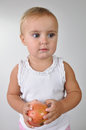 Toddler with an apple girl Royalty Free Stock Photography