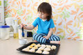Toddler bakes at home kitchen little boy Stock Images