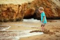Toddler on the beach little boy playing sea sand at high tide sea Stock Image