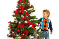 Toddler boy arrange christmas tree isolated on white background Royalty Free Stock Photos