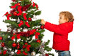 Toddler boy decorate christmas tree isolated on white background Royalty Free Stock Photos