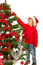 Toddler boy decorate tree christmas and wearing santa hat Royalty Free Stock Photo