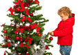 Toddler boy decorate xmas tree christmas isolated on white background Royalty Free Stock Photo