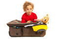 Toddler boy dreaming at vacation and sitting on luggage Stock Images