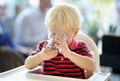 Toddler boy drinking water Royalty Free Stock Photo