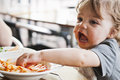 Toddler Boy Eating Pasta Royalty Free Stock Image