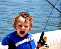Toddler Boy fishing on a boat Royalty Free Stock Photo