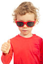 Toddler boy giving thumb up modern selective focus on hand isolated on white background Stock Photo