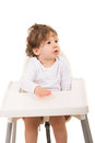 Toddler boy looking away sitting in a high chair and to copy space isolated on white background Stock Image