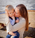 Toddler boy with mother holding him mom and kissing Royalty Free Stock Photo