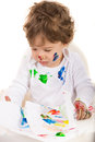 Toddler boy painting and sitting in chair against white background Stock Image