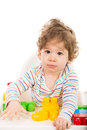 Toddler boy playing with building bricks sitting in a high chair and blocks Stock Photography