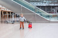 Toddler boy with red child suitcase at airport lovely three years old Royalty Free Stock Images