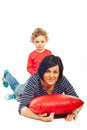 Toddler boy riding mother home and playing together isolated on white background Stock Photos