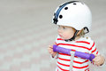 Toddler boy in safety helmet with scooter Royalty Free Stock Photo