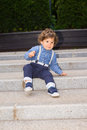 Toddler boy trying to descend stairs on the bottom Stock Photography